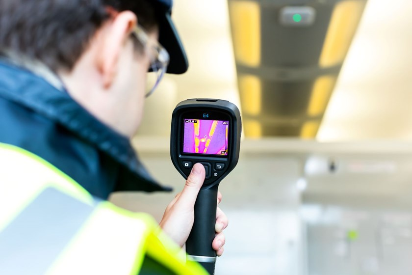 Mitie Energy Manager using a thermal imaging camera to check energy efficiency of lighting