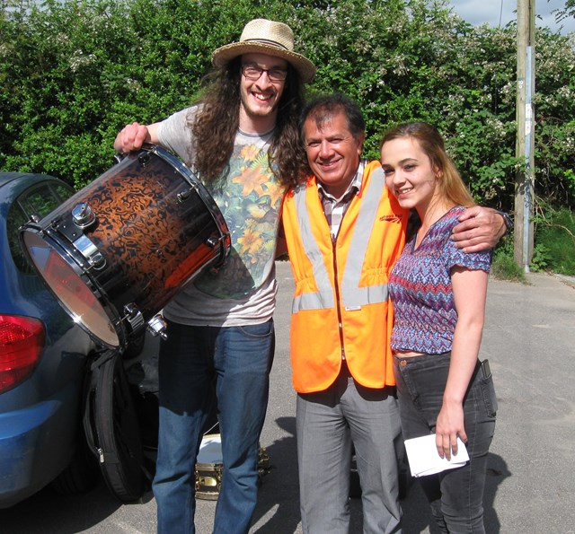 Morgan Pettigrew gets his rare stolen drumkit back from Network Rail engineer Derek Wahid 1-2
