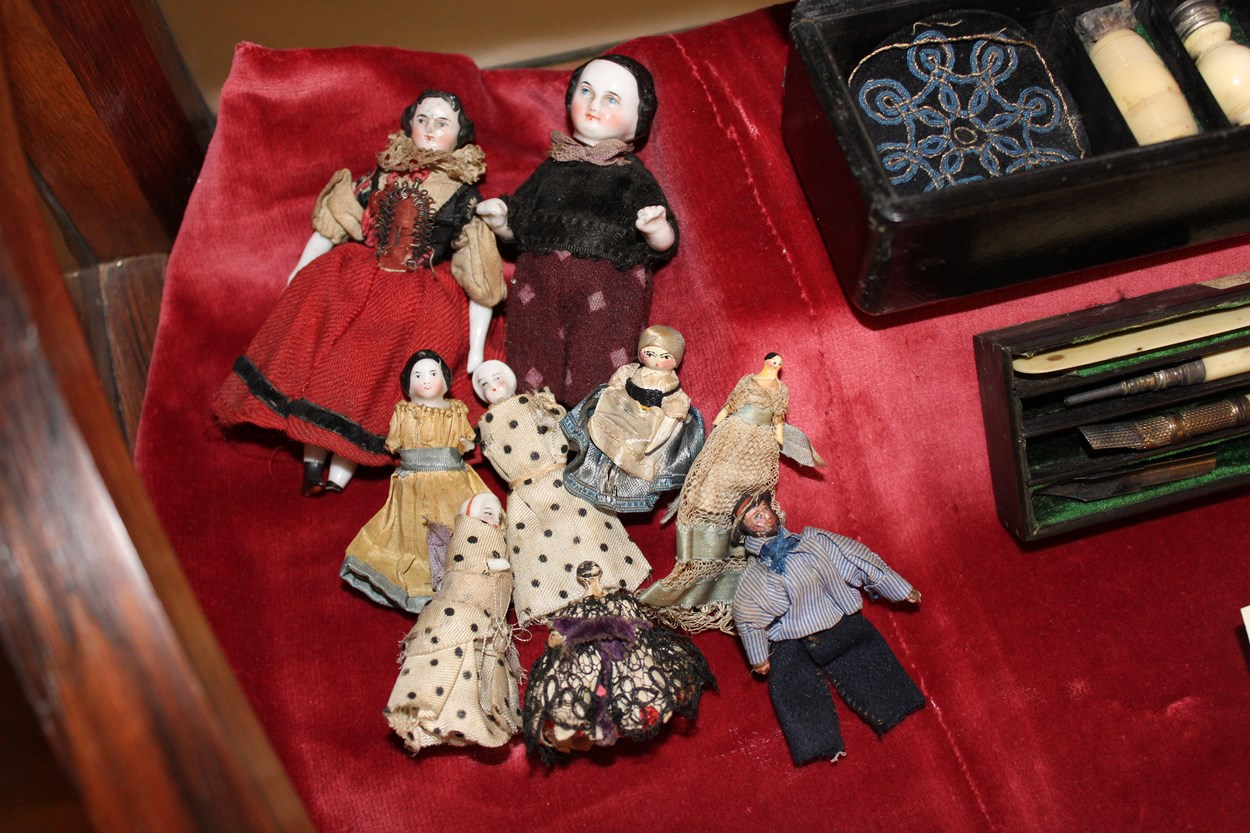 Marianne's dolls: When Florence and Marianne were children they often played with dolls. This assortment of little porcelain dolls belonged to Marianne Nicholson. She used to carry them around in a homemade purse in her pocket. The cousins could play with them anywhere.
