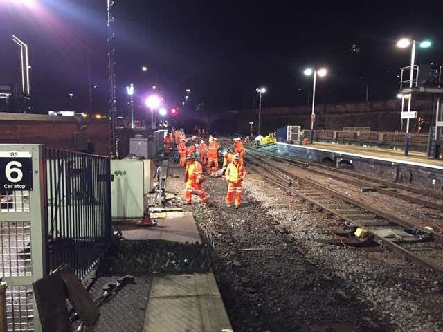 Network Rail workers carrying out track and signalling repairs after derailed freight train in Sheffield