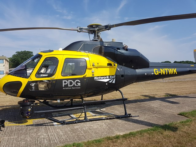 Network Rail's heat-seeking helicopter took to the skies of Surrey this week to help protect South Western Railway passengers from train delays: Helicopter at Fairoaks- 07-08-18