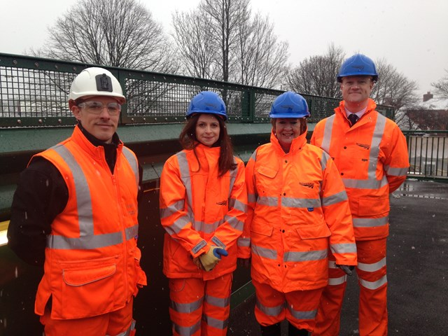 Leyland station fotbridge L-R Network Rail's project manager Sam Burger, Seema Kennedy MP for South Ribble, Cllr Margaret Smith leader of South Ribble Borough Council and Craig Harrop from Northern Rail