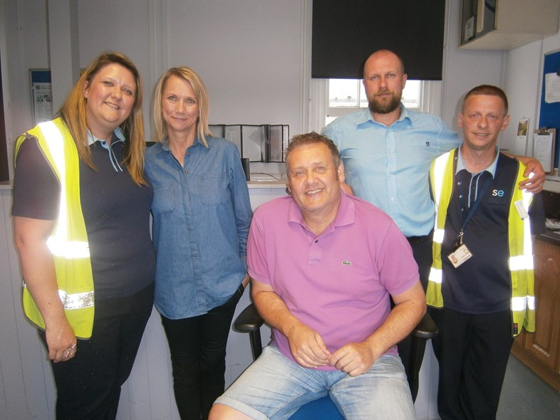 Southeastern employees hailed for saving life of Maidstone man who had a heart attack: Stuart Legg and partner Natalie Bresler with Southeastern colleagues at Maidstone East station (002)