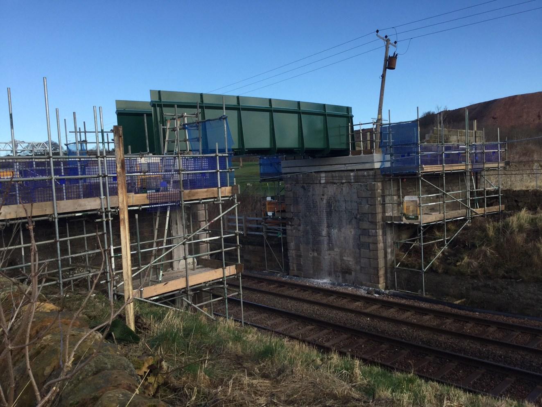 Network Rail completes Edinburgh-Glasgow bridges ahead of electrification: Niddry Castle footbridge in position above overhead wires on the main Edinburgh - Glasgow line
