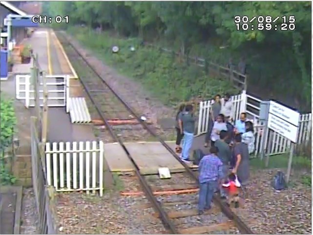 Matlock Bath - Large group of people spend  eight minutes on track taking photos (4)