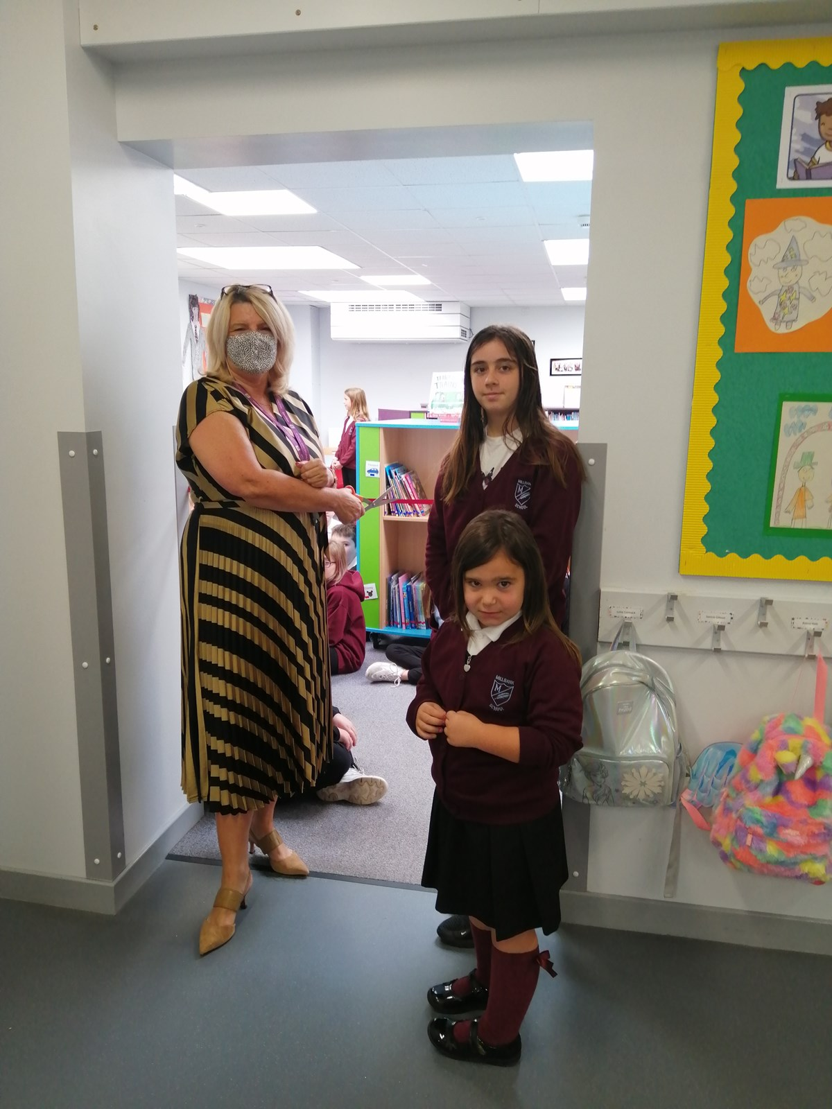 Opening of new Millbank Primary School library: Chief Education Officer, Vivienne Cross, with Lucie Scott (11) and Zuri Andrew (5), Millbank's youngest and oldest pupils.