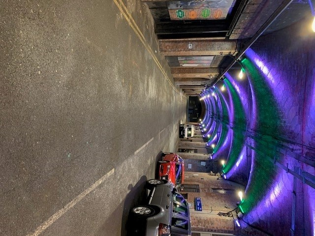 Leeds arches lit up green and blue for Blue Monday and Samaritans
