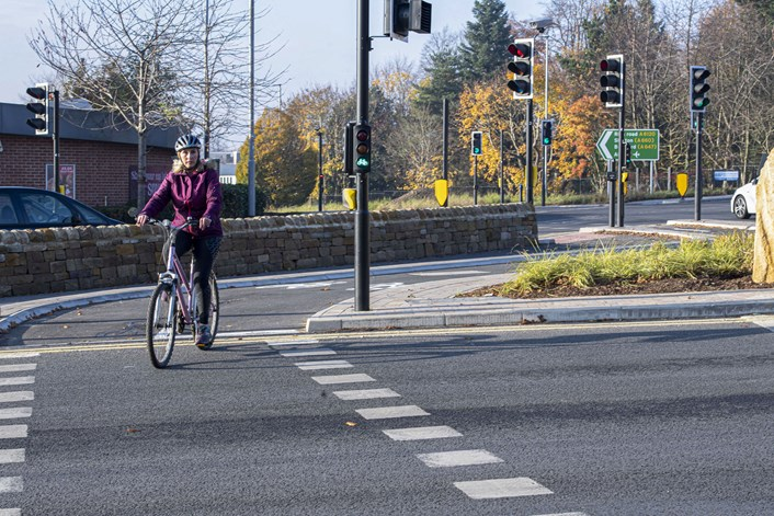 Person cycling on Moortown roundabout