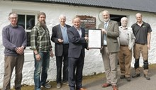SNH Chair receives Biosphere certificate: From left to right: Peter Cunningham, Donald MacIver, George Hendry, Mike Cantlay (SNH Chairman), Iain Turnbull, Tom Forrest, Doug Bartholomew (SNH). All Wester Ross Biosphere Board members (except the SNH staff).