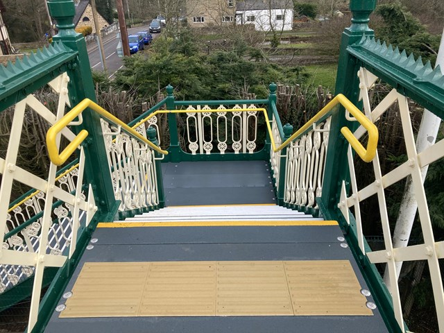 View looking down staircase of renovated Furness Vale station footbridge
