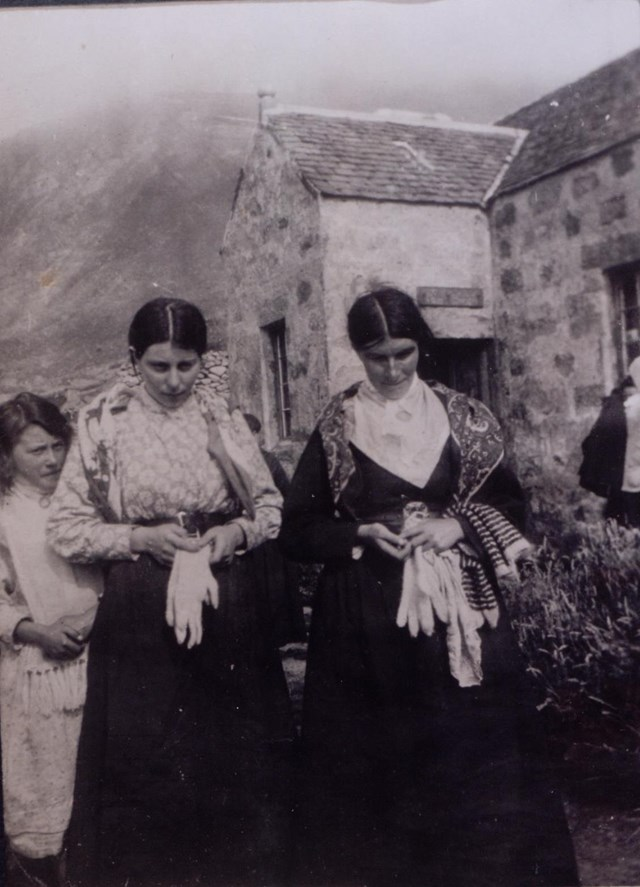 St Kilda Christina Ann McQueen: Christina Ann McQueen (centre), daughter of Finlay McQueen, outside the factor's house, St Kilda, c1913 National Records of Scotland, GD1/713/1