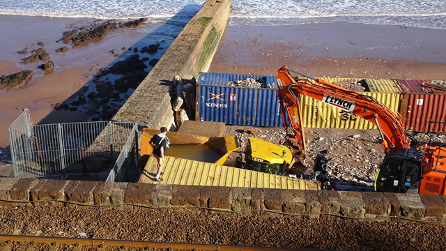 Individuals pictured ignoring the safety fencing and entering the working construction site at Dawlish.