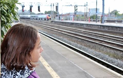 Railway Children Sleepout: Vulnerable girl (model) on platform at station