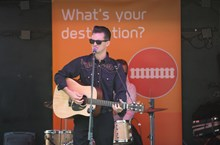The man in black: The Johnny Cash tribute act - Cash Band London - perform in front of a Thameslink Programme banner