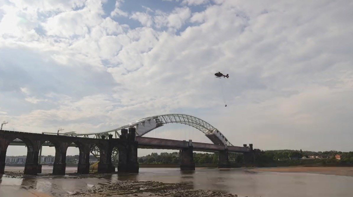 Runcorn Viaduct bell being removed by helicopter