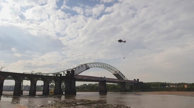 Historic navigation bell restored to celebrate iconic viaduct's 150th birthday: Runcorn Viaduct bell being removed by helicopter
