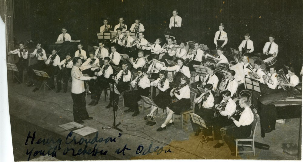 Sounds of Our City: Photograph of Leeds Youth Symphony Orchestra, Conductor Mr Henry Croudson, taken at the Odeon Cinema, Leeds, 1943.