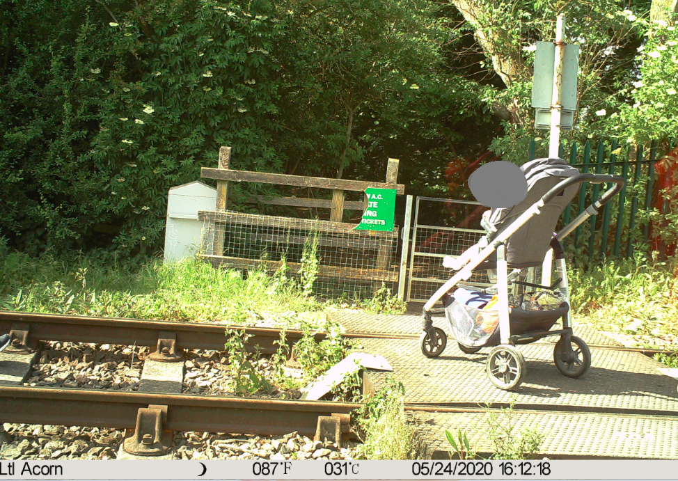 Shocking picture captures the moment a child was left on tracks as worrying stats show surge in people risking their lives at level crossings: A small child was left on the tracks at Marlow