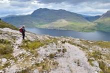 A hillwalker enjoying the view in the Higlands Credit Lorne Gill-NatureScot