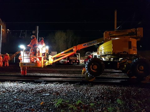 Team Orange working to connect overhead power lines at Preston
