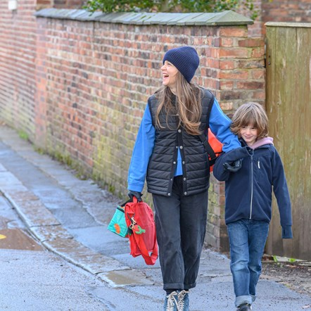TfGM mother and son walking to school through active neighbourhood square