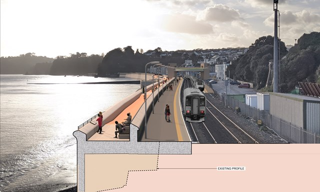 View of new promenade towards Dawlish station with train