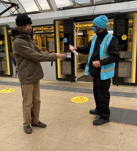Vic DOA4: TravelSafe's Partnership staff stood on the Metrolink platform at Victoria during their 50th day of action targeting face covering compliance.