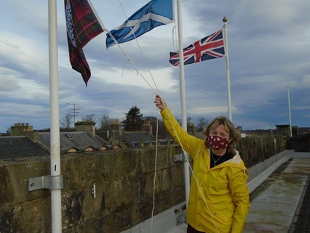 Corporate Parenting Manager, Jennifer Gordon, hoists the Care Day flag at Moray Council HQ