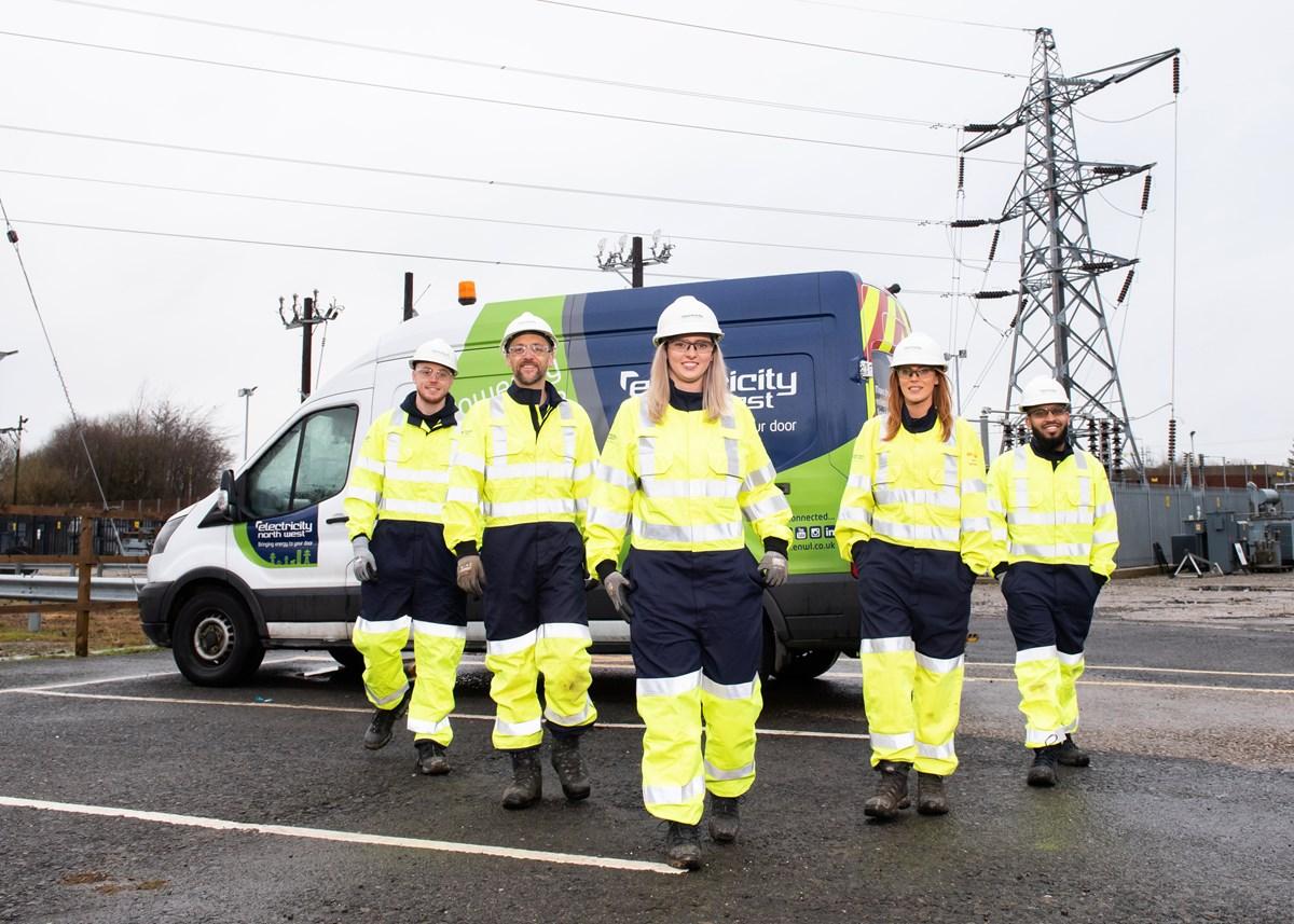 ENWL apprentices beside electricity pylon: ENWL apprentices (Photo credit: Sara Porter Photography for Electricity North West)