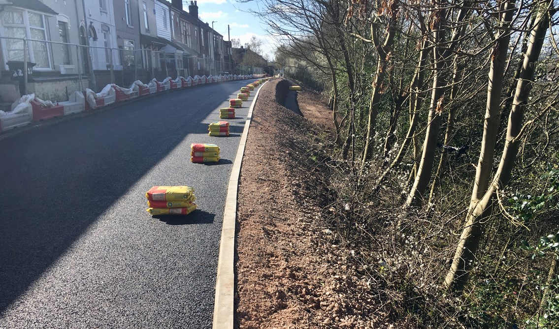 Next phase begins to secure moving residential street beside the West Coast main line: The secured earth at West Parade in Stoke-on-Trent in Spring 2019