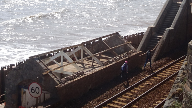 People trespassing on the railway line east of Dawlish station underneath Coastguard footbridge