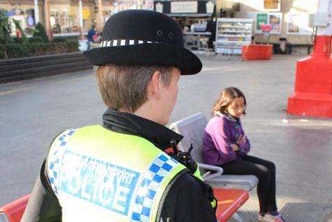 Railway Children Sleepout: BTP officer approaching girl (model) sat alone in station
