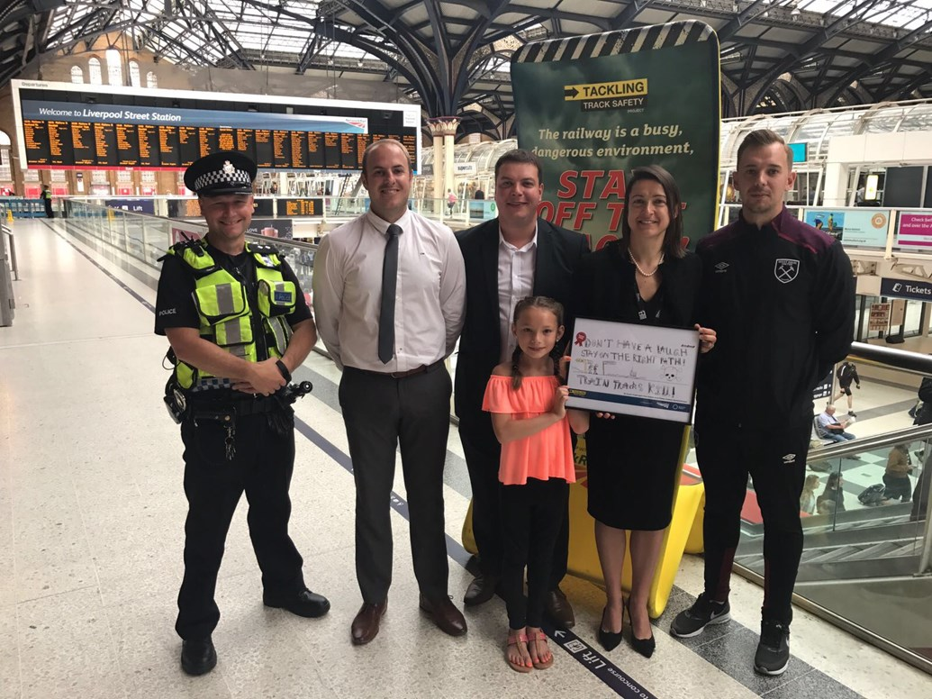 Nine-year-old girl from Stanford-le-Hope designs new national railway safety campaign: Winner Summer with representatives from Network Rail, BTP and West Ham United Foundation Club