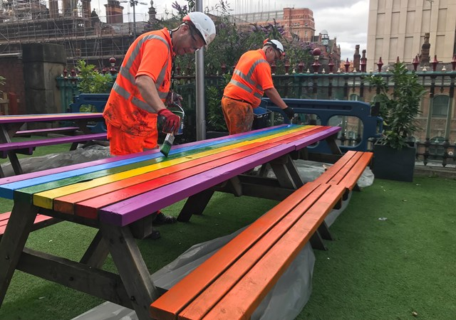 The picnic benches getting the Pride treatment at Manchester Piccadilly