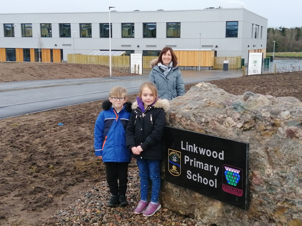 Linkwood Primary School Head Teacher Fiona Stevenson with P3 pupil William Forbes and P2 pupil Louise Buchan
