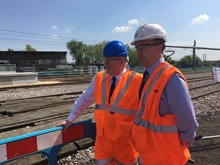 Surveying progress at the new Cambridge North station: Secretary of State for Transport, Patrick McLouhglin (left) and Network Rail route managing director Richard Scofield (right) survey work to build a new station at Cambridge North (12 May 2016)