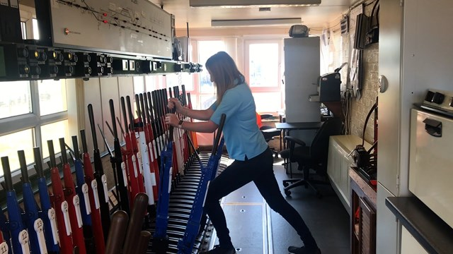 Amy working signal lever at Sellafield signal box