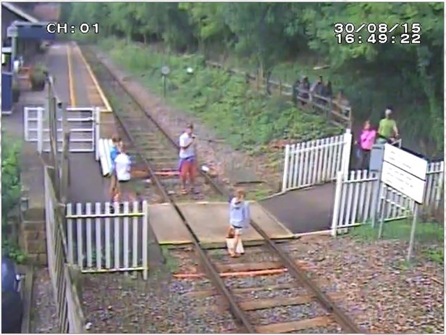 Matlock Bath - Man takes a picture of child on the track