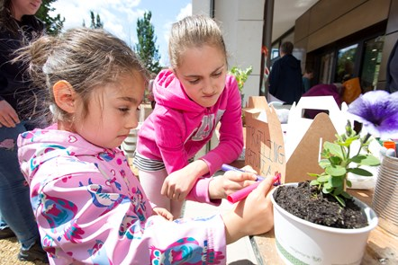 Children enjoy gardening activities at the grand opening of the Caledonian Clock Tower, on June 8 2019