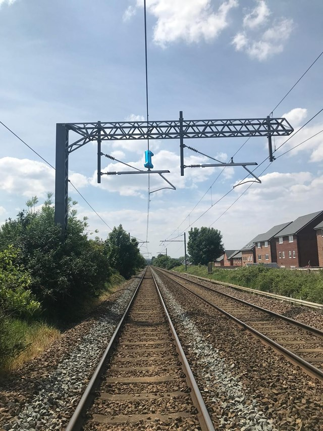 Portrait shot of the balloon on the overhead lines at Prescot