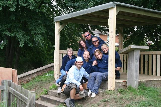 TV4 BTCV - Handsacre: Network Rail volunteers sitting in the pergola they built at Hayes Meadow school.