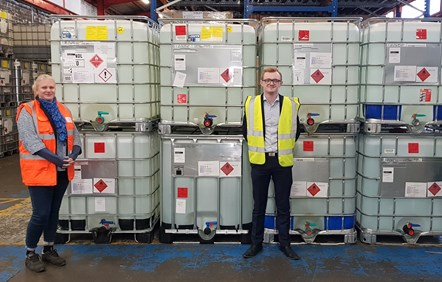 Aista Jukneviciute of Penderyn, with Jarl Hobbs of Lovair in front of IBCs of sanitizing liquid.