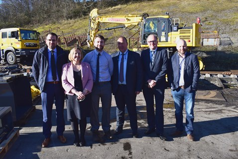 Lynne Neagle AM (second left) with Carl Jones, director of rail engineering, G.O.S (third left) and Wayne Gregory, managing director, G.O.S (third right) and representatives from Network Rail