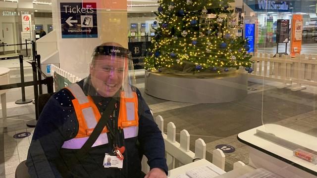 Dan Noon behind the customer services desk at Birmingham New Street Christmas 2020