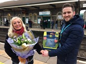 IMG 2183: Station Manager Thomas Owens presents Sharon Owen of Welsh Hearts with flowers after her generous donation of a defibrillator.