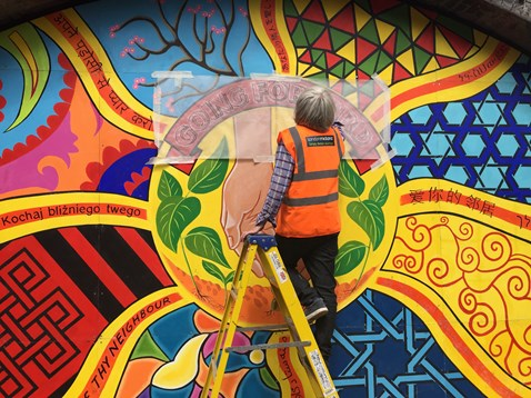 The finishing touches to the new mural at Smethwick Rolfe Street station