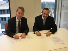 Emyr Roberts, chief executive of Natural Resources Wales & Andy Thomas, Network Rail Wales route managing director signing the memorandum.