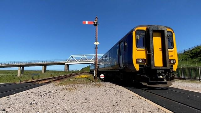 Northern train approaching Sellafield signal box