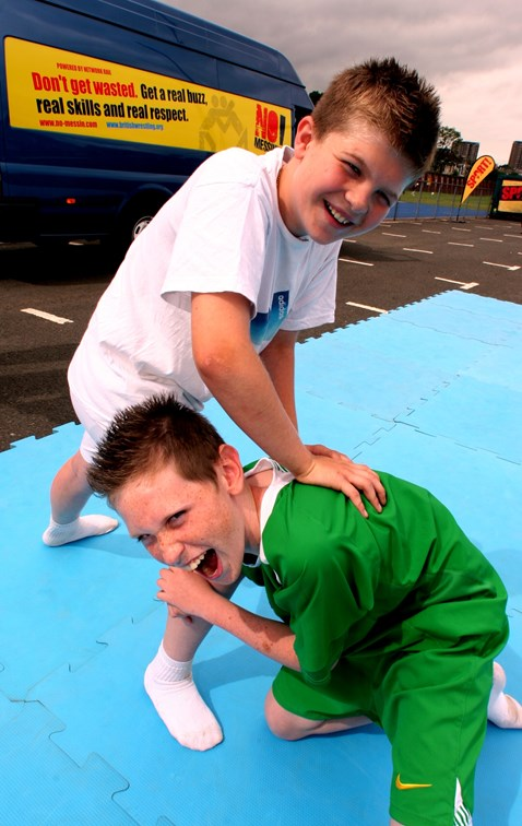 Ryan Smith (12) and Ciaran Barbour (12) wrestling at No Messin' Live! - Crawley