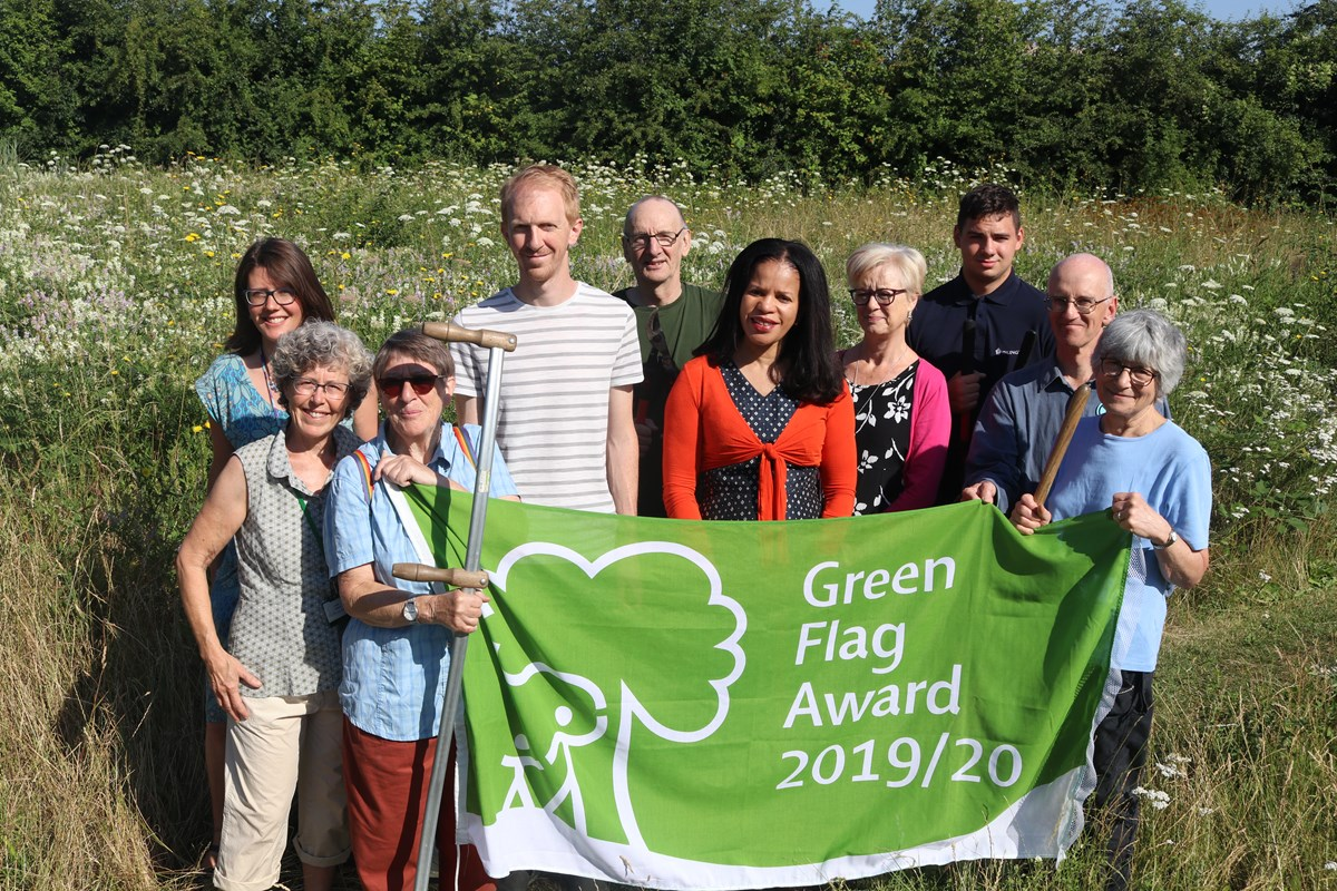 Cllr Claudia Webbe, centre, and Friends of Gillespie Park chair Sue Jandy (fourth from right), celebrate the Green Flag Award with staff and other members of the Friends group.